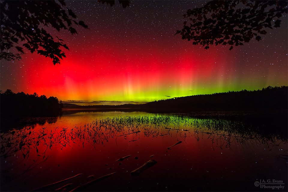 Aurora Borealis. Near Gile Pond in Sutton, NH by Garrett Evans