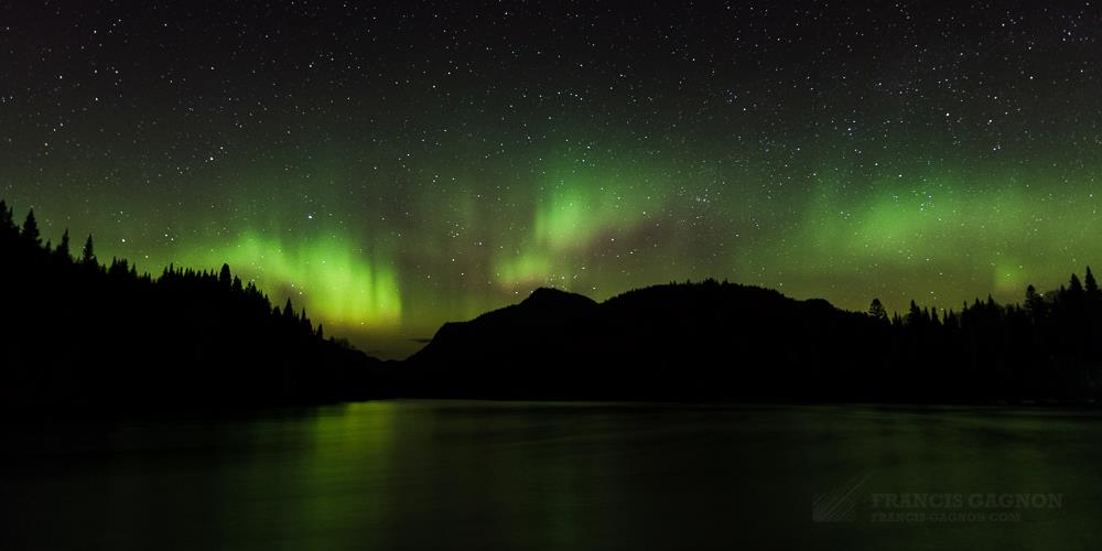 Aurora Borealis. The Rivière Jacques-Cartier, Quebec, Canada by Francis Gagnon Photography